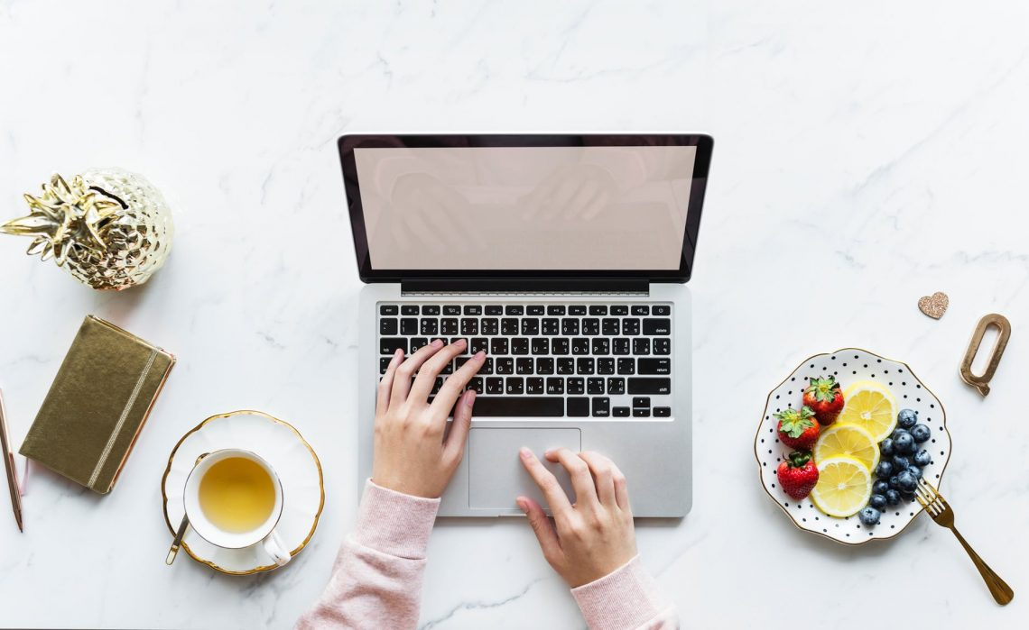 Social Media Best Practices- computer and fruit bowl